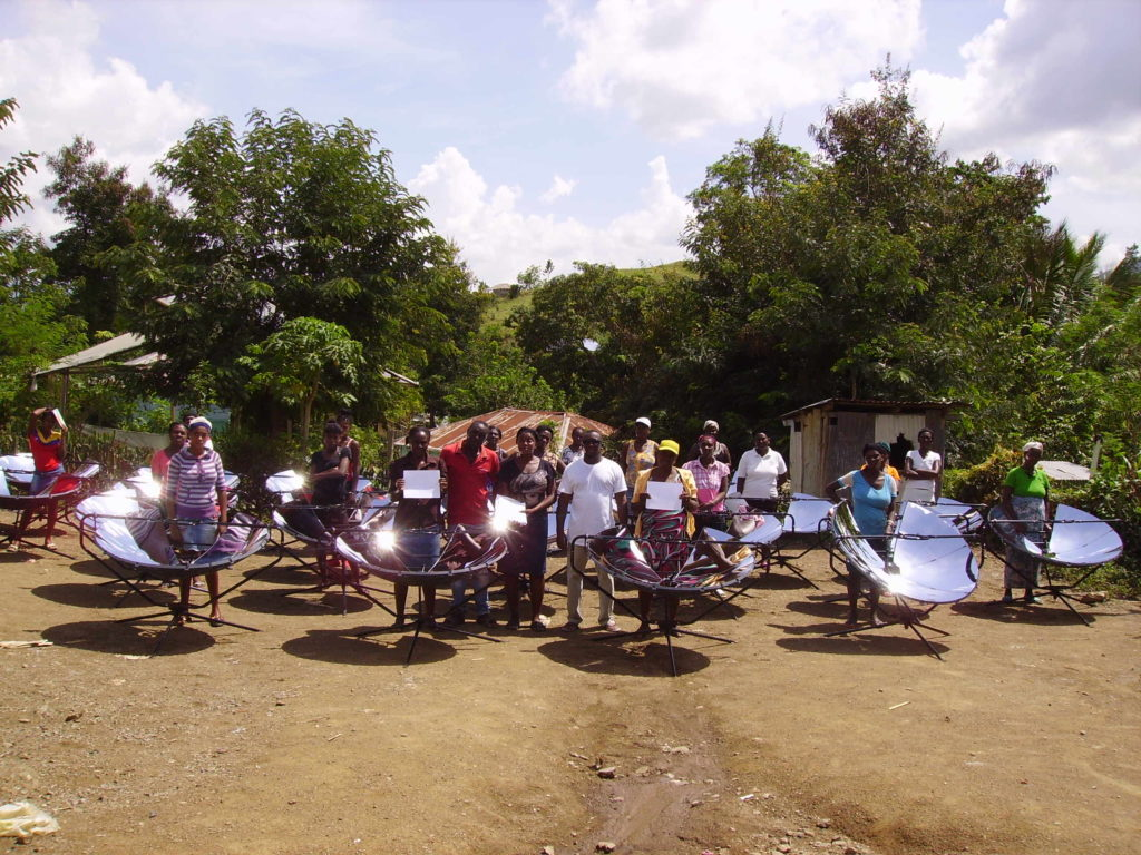 Haiti-villagers-with-solsource-solar-cooker