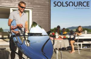 man solar cooking with solsource solar cooker on terrace